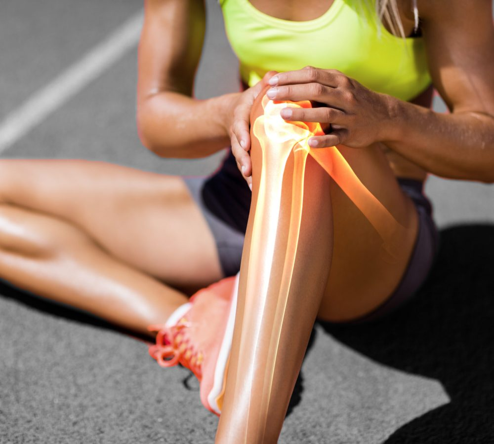 Low,Section,Of,Sportswoman,Suffering,From,Knee,Pain,While,Sitting
